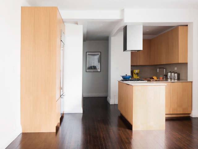 an open kitchen in murray hill: a beautifully appointed modern kitchen, open to 75