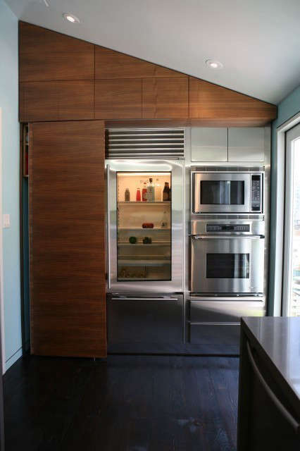 noe street kitchen: a sliding walnut panel (left) hides a stacked washer and dr 27