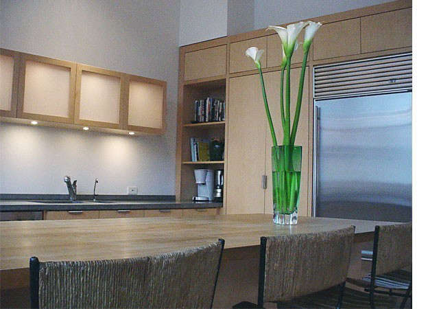 th street: a kitchen composed of white maple, sandblasted glass and concrete