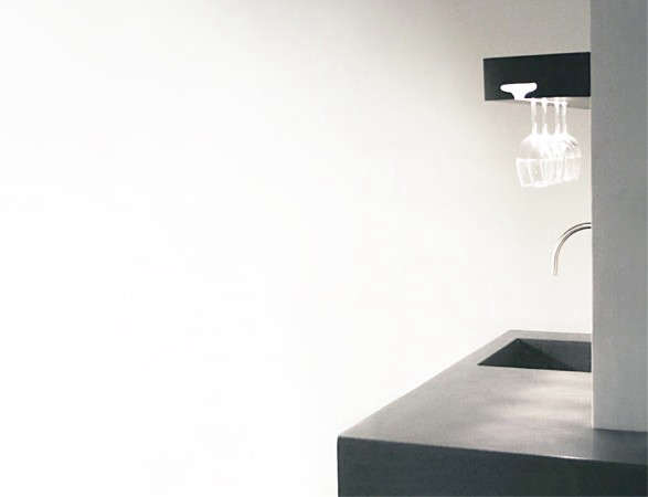 79th Street: the profile of a wineglass carved into a Walnut shelf, lit by LEDs, gives away the function of the room