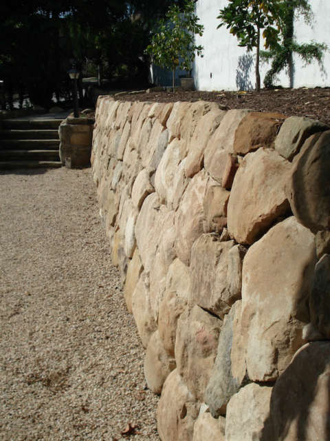 new wall: formerly a big pile of trash and stones, plants and weeds 11