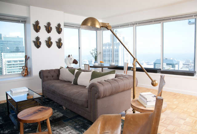 Geremia Design San Francisco Penthouse: This downtown penthouse is kind of the ultimate SF bachelor pad. The owner had no furniture so we got to start completely from scratch. The custom art in this space is really exciting, especially the eye catching mural on his bedroom wall.