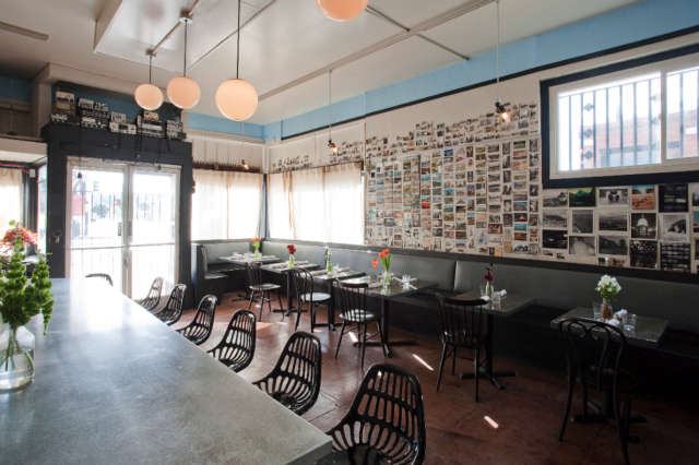 Geremia Design Citizens Band: Since the chef/owner at Citizens Band is my friend, this project was really fun and collaborative. We worked together to find materials at local salvage yards that we could repurpose as design elements. We did the bar with pallets of found heath ceramic tile and created an art installation that pulled from my personal collection of postcards and illustrations. Photo: Keeney+Law