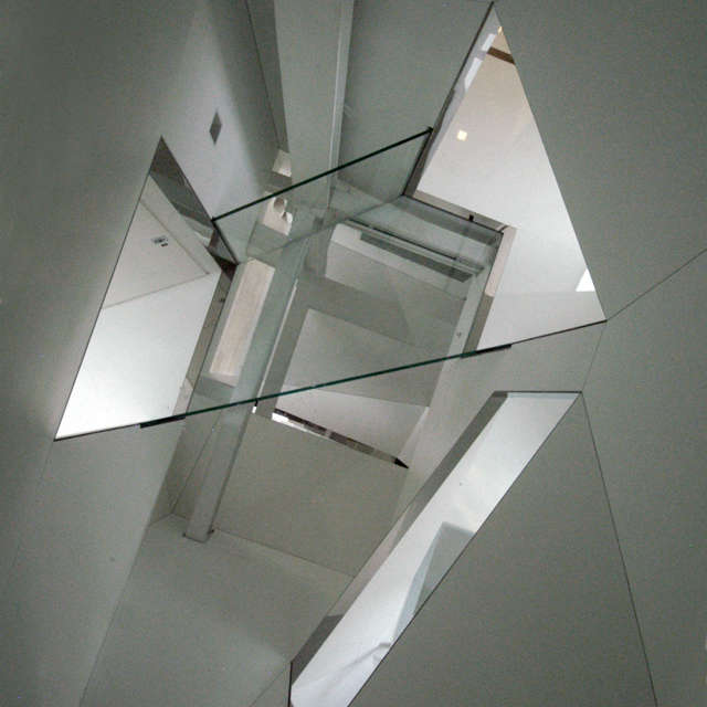 stairwell viewed from attic: the glass floor at attic level offers a view down  19