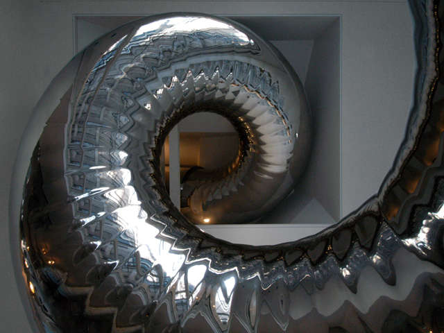 slide emerging from library ceiling: the slide coils down from the bedroom leve 20