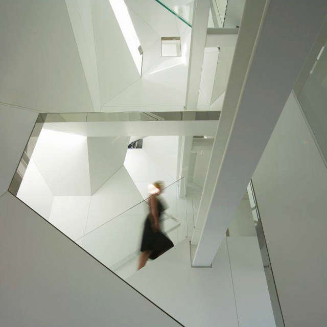 stairwell view to stair: the stair wraps the perimeter of the twisting stairwel 23