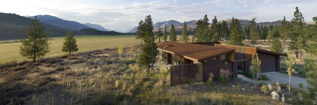 wolf creek residence: the wolf creek residence sits in a lightly treed meadow,  53