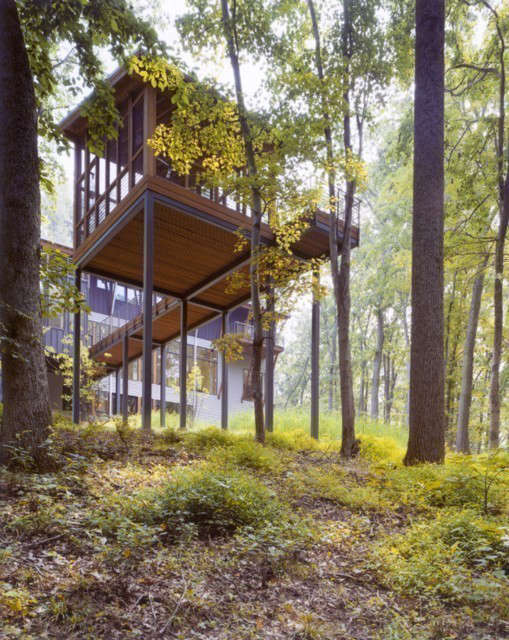 house in the woods: a bridge connects the house and the screened porch. photo:  28