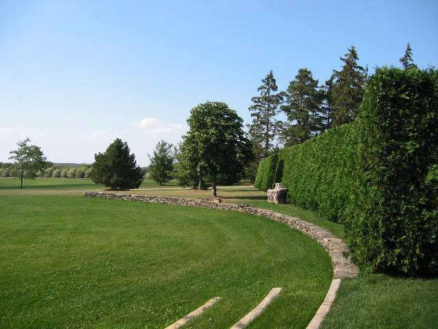 midwestern farm: allée of willows in the distance.: the low crescent embraces  12