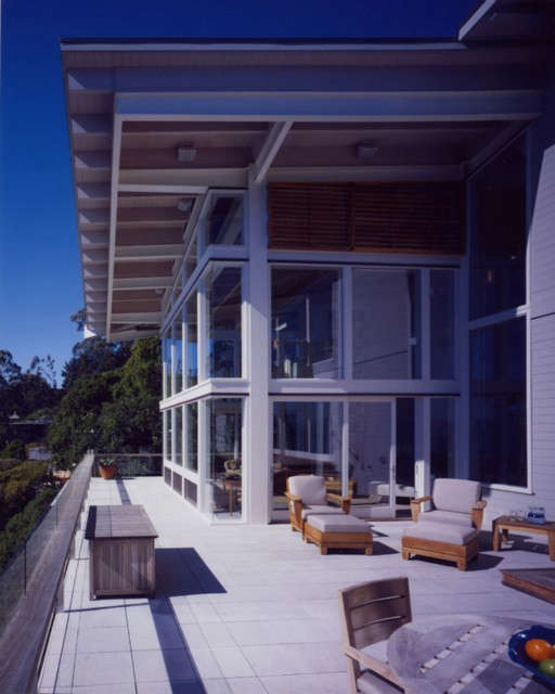 """OGAWADEPARDON San Francisco House: SF House&#8\2\1\1; Located on the cliffs of the San Francisco shoreline, the architects radically transformed the structure to accommodate a seismic upgrade. The dramatic redesign of this modern house took full advantage of the home's breathtaking views.The original house worked against the spectacular site. """"With its massive over scaled roof and heavy timber detailing, reminiscent of Polynesian architecture, the house dominated the site, without taking advantage of the incredible view."""