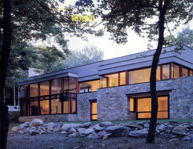 """OGAWADEPARDON Stone* House: Located in Pound Ridge, NY, this stone & wood house was commissioned as a spec. house to be built within a very tight budget. The house was sited deep into an embankment overlooking a beautiful 4 acres pond. By opening up the house through large expanse of glass, we used the Japanese concept of """"borrowed views"""" to bring the picturesque landscape into the house."""
