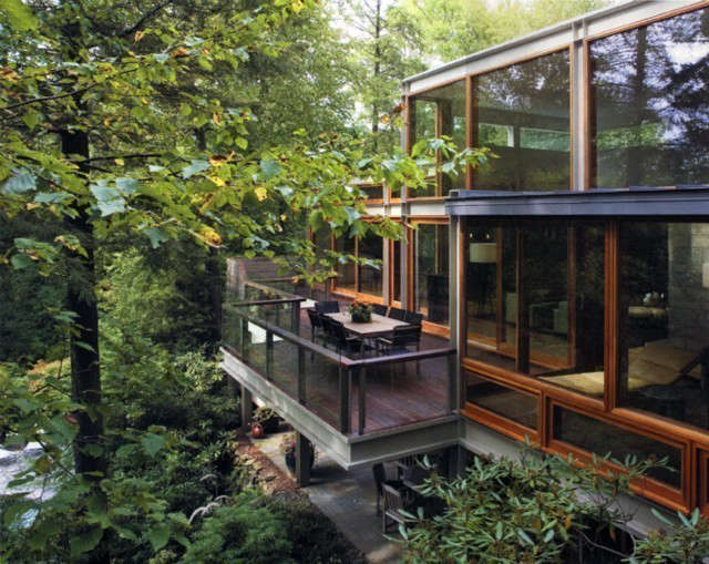 OGAWADEPARDON Modern Tree House: Ogawa / Depardon was commissioned to renovate & restructure an existing modernist house in Bedford, New York.The design consisted of tearing off the back wall of the house & restructuring it with a steel frame. This allowed very large custom wood & glass windows to be introduced giving full unencumbered access & views to the beautiful site.The house was gutted & modernized throughout.