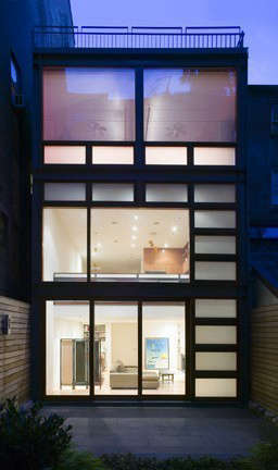 OGAWADEPARDON West Village Glow*: West Village Glow*&#8\2\1\1; After the removal of a ramshackle greenhouse appendage at the rear of this townhouse, a new facade of exposed structural steel and large custom wood windows brought light and warmth into the kitchen and family room that face the rear garden. The owner wanted a design that was complimentary to their collection of mid century modern furniture, lighting and decorative objects.