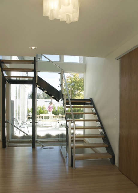 House For Two Chefs, entry stair with courtyard beyond