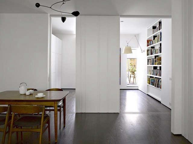 slide apartment: a series of white matt lacquer scalloped door panels slide int 16