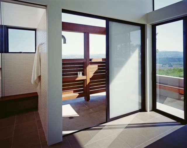 ridge house: indoor and outdoor showers. photo: sharon risedorph 12