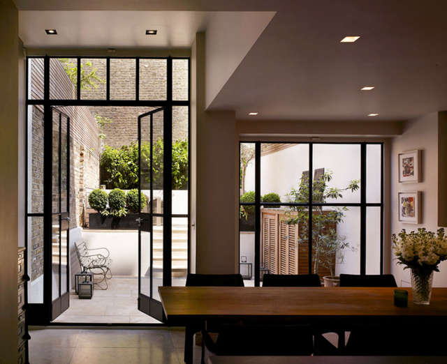Notting Hill House (3): The narrow facade of this West London house hides an interior of rich volumes. Reconstructed behind a retained facade, the new generous floor to ceiling heights along with the introduction of sliding walls and glazed screens create a light and spacious family home. Photo: Kilian OSullivan