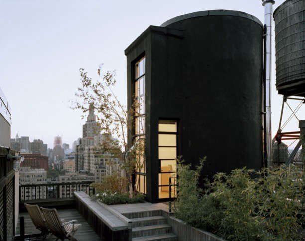 tank house: a tree house perched high in a city of towers and skyscrapers. the  11
