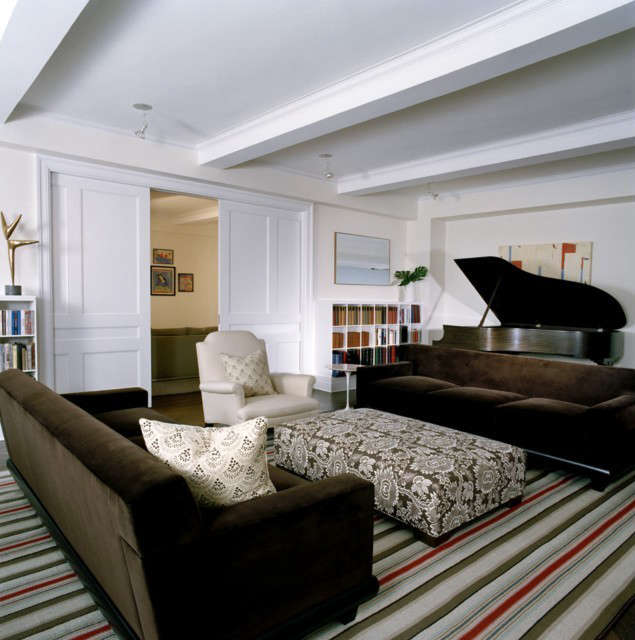 apartment renovation, new york city: a custom bookcase with modern proportions  20