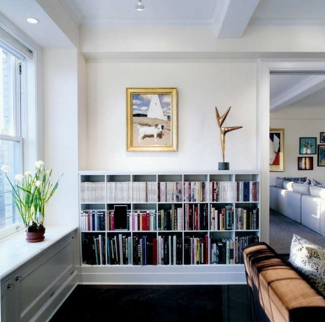 pre war apartment, living room bookcases: a custom bookcase with modern proport 21