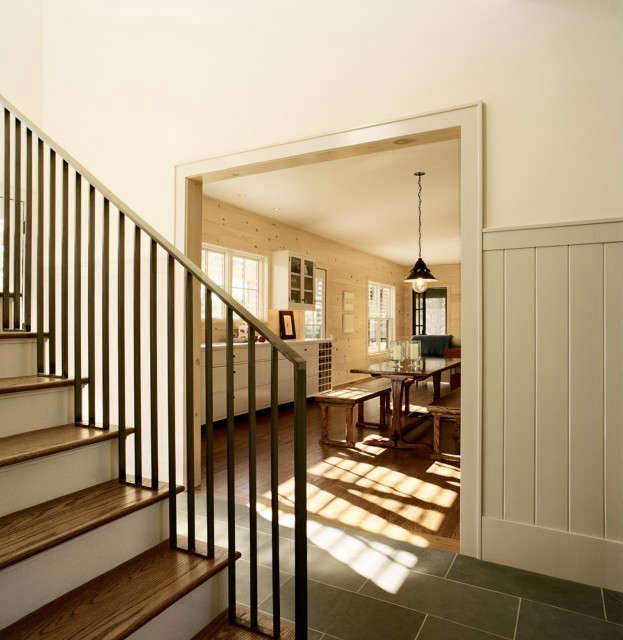 weekend house, norfolk, ct: double height entry foyer with a stair leading to t 17