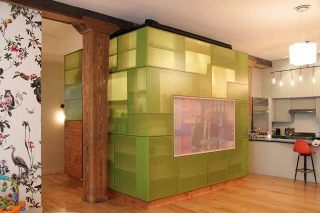 MESH Architectures Horatio Street Loft: A loft in the West Village transforms an old stable into a unique living space. Almost a square, the entire loft was designed around a media library seen here as a transluscent cube. This intimate library space serves to contrast and balance the capaciousness of the loft. Photo: Eric Lifting