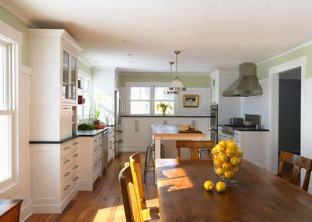 Albertsson Hansen Architecture Hastings Farmhouse: This family farmhouse received a major update. White painted cabinets replaced the dark stained wood ones and brighten up the space. Photo: Susan Gilmore