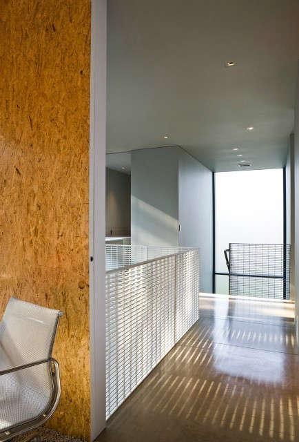 house on lake okoboji: view of hallway looking towards stairs with steel grate  18