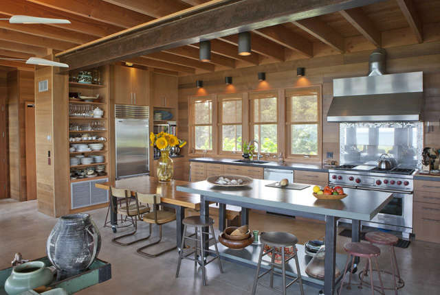 East Chop Residence: This open kitchen allows plenty of work space for a family that enjoys entertaining, and includes moveable hydraulic work surfaces that convert to dining tables. Photo: Peter Vanderwarker