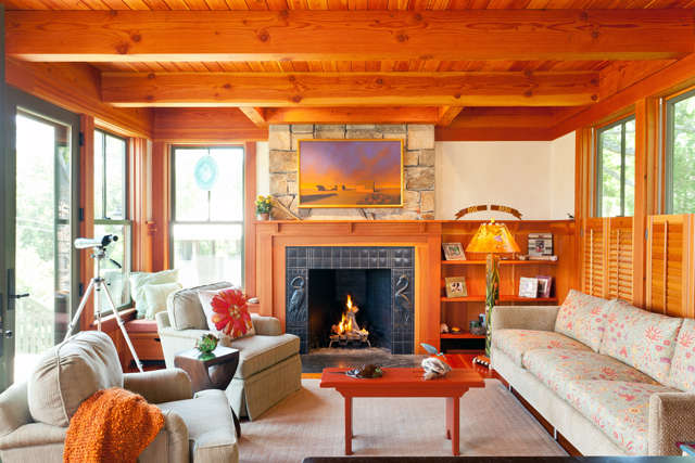 Oyster Pond Cottage: This detailed, charming cottage has exposed framing and rich interior and exterior details. The interior exudes an old cottage feel and casual elegance, with fir walls and floors, and colored plaster walls. Photo: Dan Cutrona
