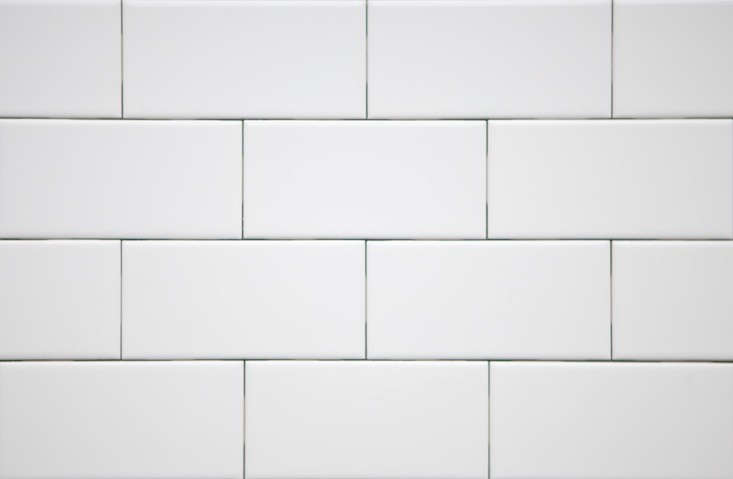 A patch of subway tile sits behind the wash basin: Three-by-Six-Inch Ceramic Tile is available from Subway Ceramics; inquire about showrooms and pricing.