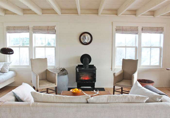at harbor cottage in maine, all the furniture, even the woodstove, has been dow 9