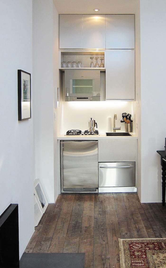 A tiny kitchen by Mesh Architectures, a member of the Remodelista Architect and Designer Directory, occupies a nook in a 300-square-foot art dealer&#8