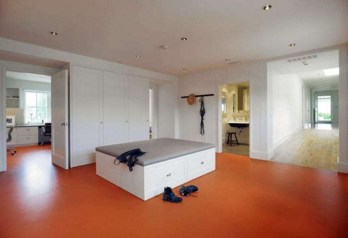 Architect E. B. Min of San Francisco firm Min|Day, a member of the Remodelista Architect/Designer Directory, installed an orange linoleum floor in the mudroom and office of a Sonoma ranch house. &#8