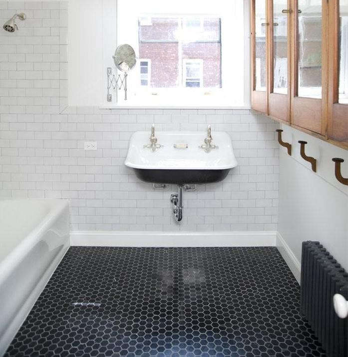 Placed for convenience, a white outlet is oriented horizontally to fit the flow of the tile in the bathroom of a Brooklyn brownstone renovated by Elizabeth Roberts, a member of the Remodelista Architect/Design Directory. See A Brownstone in Brooklyn, Reborn to tour the whole project. Photograph by Sean Slattery.