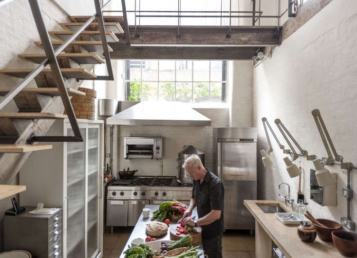 London-based Alastair Hendy designed his East End loft kitchen like a commercial kitchen, with industrial stainless steel and a robust Zanussi range and broiler.