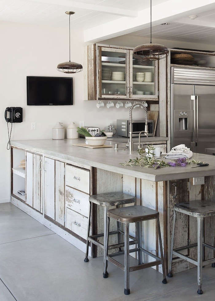 The kitchen of actress turned designer Amanda Pays features matte-finished concrete countertops, as well as floors, all of which were cast in place. &#8