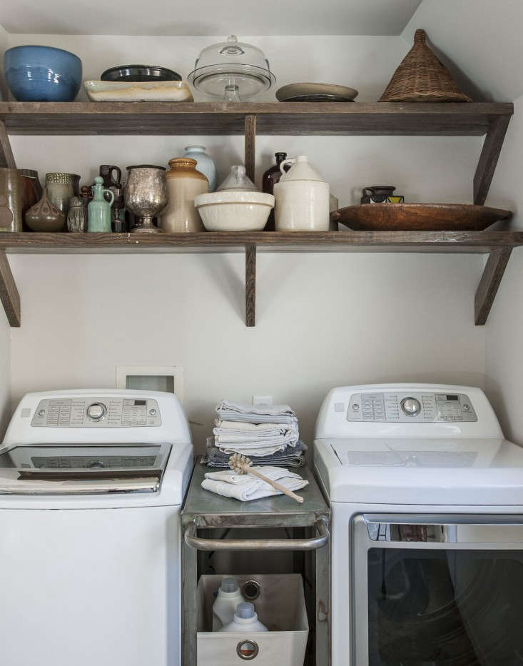 For extra storage (and to fill a gap), actress-turned-designer Amanda Pays fit a steel cart between a washer and dryer, bought at a discount at a big-box store. For more, see Rehab Diary: Amanda Pays and Corbin Bernsen Air Their Dirty Laundry.