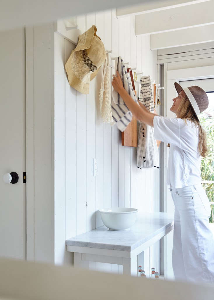 Peg rails keep summer essentials at the ready in A Chic Fixer-Upper on Fire Island, Budget Edition.