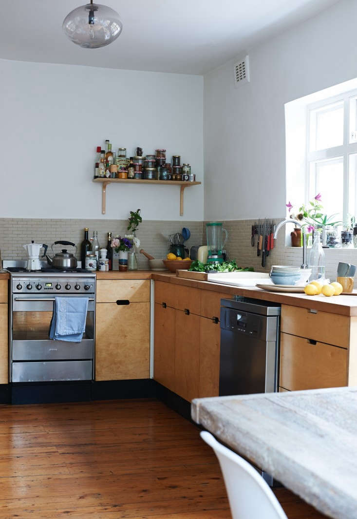 The kitchen of chef and cookbook author Anna Jones is where she shot her book A Modern Way to Eat. Jones opted for plywood cabinets, a tiled backsplash, and Smeg appliances in her East End kitchen.