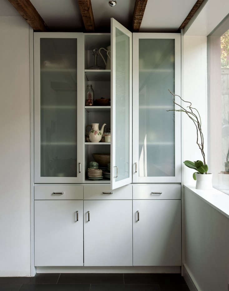 A glass cabinet inRehab Diary: A Hardworking Brooklyn Kitchen by Architect Annabelle Selldorf.