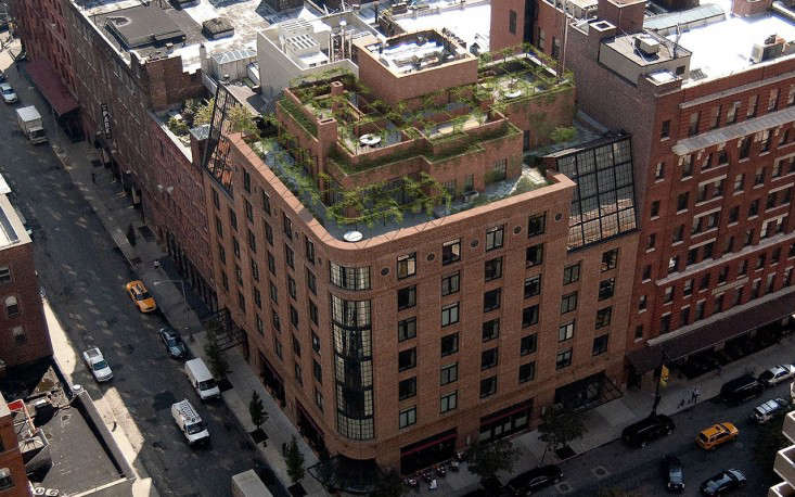 The penthouse suite, which floats atop the Greenwich Hotel on the corner of Greenwich Street and North Moore Street, is surrounded by a bi-level, 4,000-square-foot roof garden.