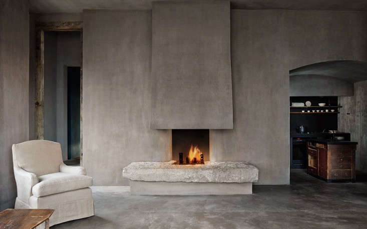 In the living room, the fireplace is a focal point; the iron fire grate is fashioned from joist hangers that, in a previous life, served as the original structure of the Louvre, in Paris.