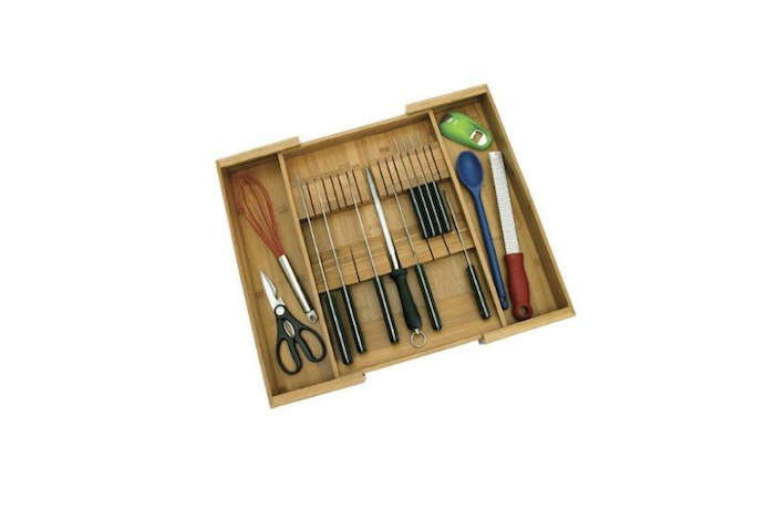 The Bamboo Expandable Knife Organizer by Lipper International stores kitchen knives and utensils; $src=