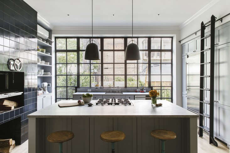 The kitchen is at the back of the building, which in most Brooklyn Italiante structures is cramped and dark. Here, Roberts had a steel-framed window wall fabricated by Optimum Window. See more in Brooklyn Revival: A Bright and Open Family House by Ensemble Architecture.