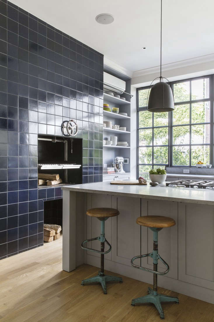 The bulk of the renovation budget went into the kitchen. Roberts, a stickler when it comes to high-functioning kitchen design, integrated a downdraft vent with the pro kitchen island range.