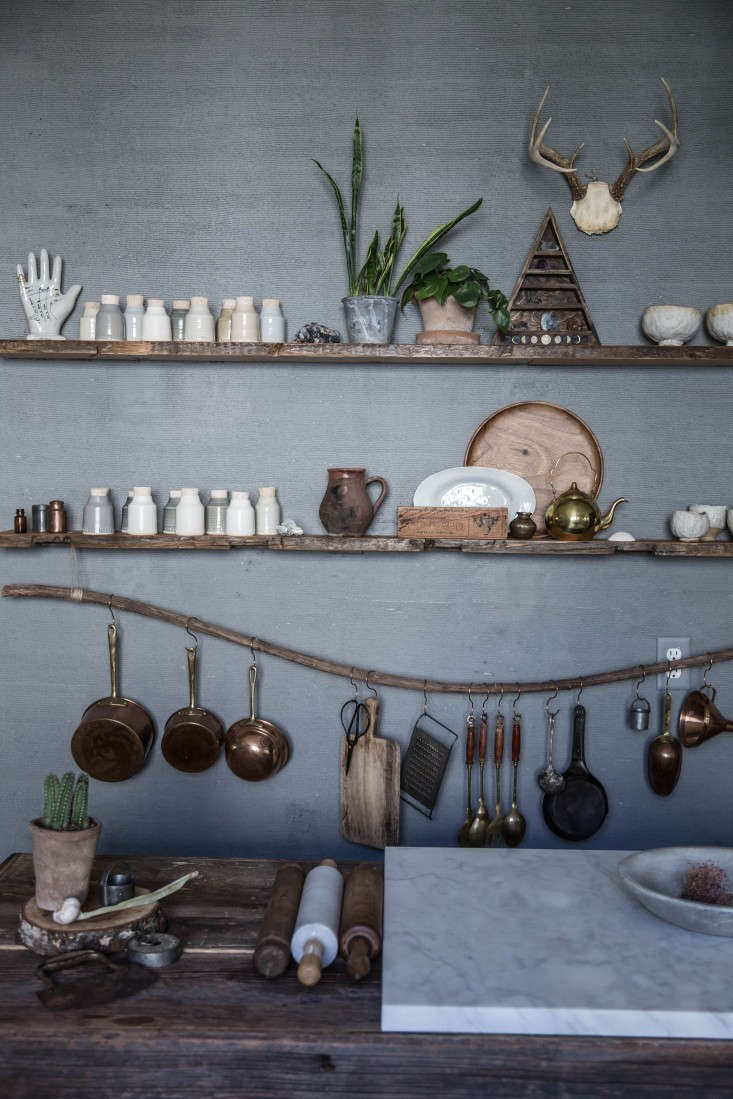 """The New Rusticity 11 DIY Ways to Use Branches Indoors Another variation on the theme in Beth Kirby&#8\2\17;s Chattanooga, Tennessee, kitchen by Jersey Ice Cream Co. This one is curved driftwood found at a """"ramshackle&#8\2\2\1; salvage shop in Chattanooga. (Kirby notes that she also uses branches as curtain rods.) SeeThe One Month Makeover: Beth Kirby's Star Is Born Kitchen."""