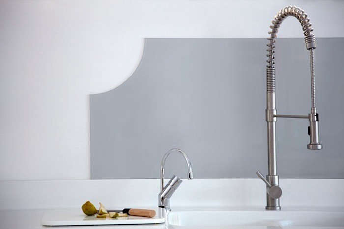 blakes london corian countertops grey glass backsplash remodelista 10