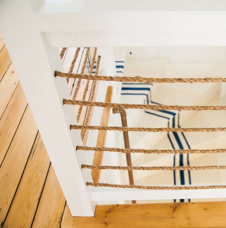 in a connecticut summer cottage, arope enclosure surrounds stairs with a naut 12