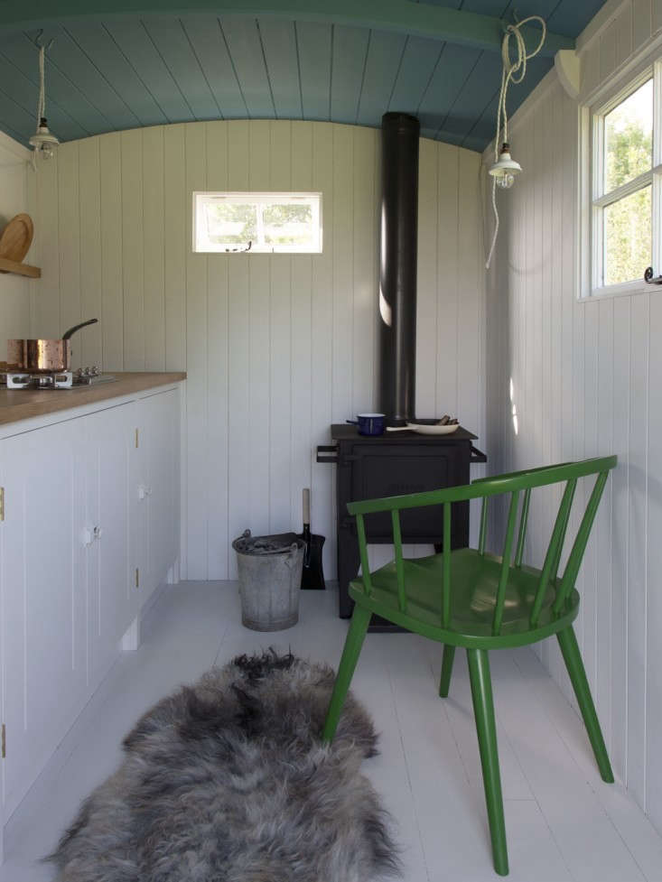 a tiny british standard kitchen outfitted in shiplap walls (and a blue painted  20